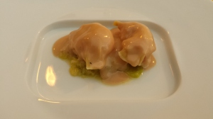 Langoustine ravioli with goose liver sauce and green cabbage