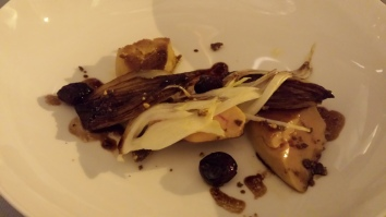 fresh duck foie gras with balsamic vinaigrette, hazelnut crumble, cranberries and caramelized endives