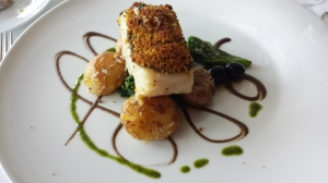 Cod fish with a maisbread crust topped with hot olive oil