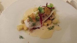 Steamed fillet of plaice with quinces, lemons and walnuts, Crémant Sauce and polenta crisps