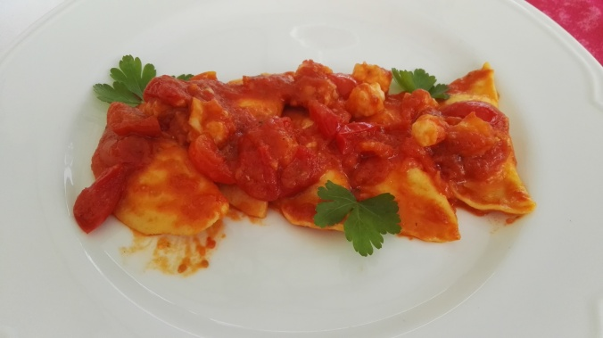 Ravioli filled with scallops and a shrimp sauce